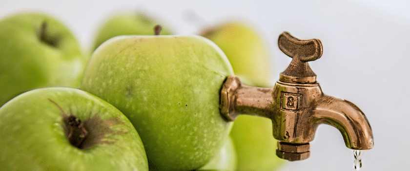 Apfel mit Zapfhahn
